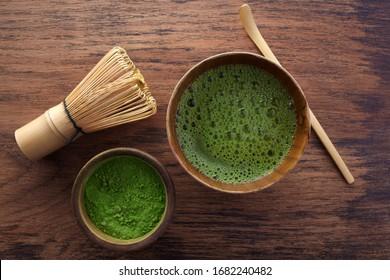 Set with green matcha tea on wooden background. Japanese tea ceremony. Food menu background. Tea ceremony set.