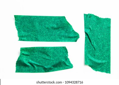 Set of green tapes on white background. Torn horizontal and different size green sticky tape, adhesive pieces.