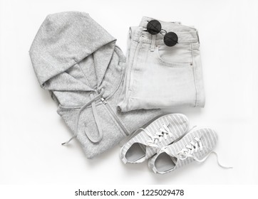 Set of grey casual clothes and accessories on white background. Top view point, flat lay.