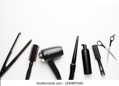 Set of hairdresser's accessories on white background