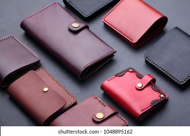 Set of hand made leather man wallet . Multi colored. Leather craft.On dark background.Top view.Selective focus