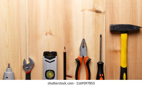 Set of hand tools on wooden table. Instruments on wooden background. Repair tools. Top view. Flat lay. Close-up. Copy space