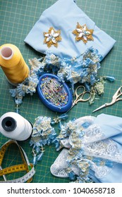 Set for handiwork: Scissors, thread, pins, centimeter, needles, ornaments