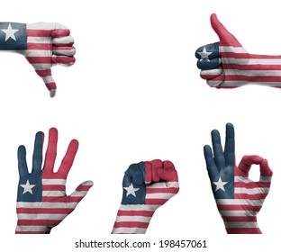 A set of hands with different gestures wrapped in the flag of Liberia