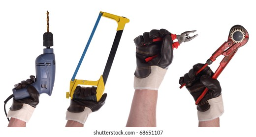 A set of hands with working gloves and different tools.