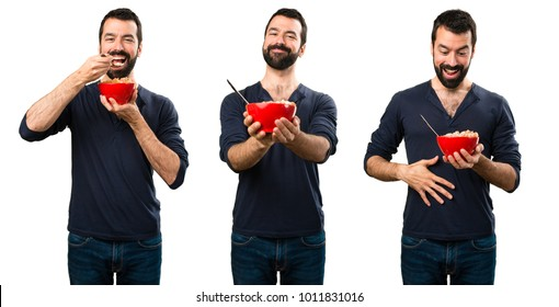 Set of Handsome man with beard holding a bowl of cereals