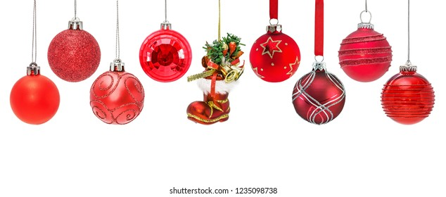 Set of hanging red christmas baubles. isolated on white background.
