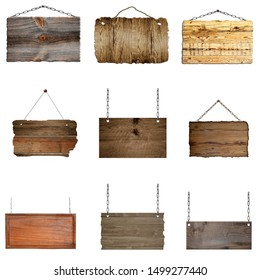 Set of hanging wooden signs on metal chains background