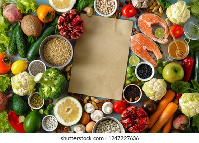 Set healthy food with paper bag (cereals, seeds, fish, vegetables and fruits) Top view. Flat lay