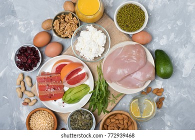 Set of healthy protein source food. Salmon, chicken breast, eggs, soft cheese, beans, avocado, nuts and other healthy food ingredients. Healthy eating and diet concept