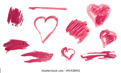 A set of hearts, lines and smudges, drawn with red lipstick on white background