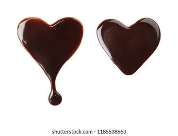 Set with hearts made of molten chocolate on white background