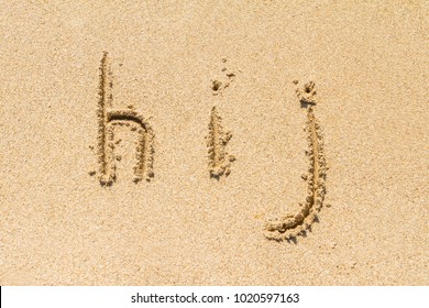 Set of hij letters of alphabet written on sand with lower case.