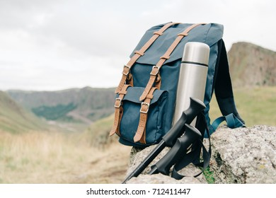 Set of hiker equipment in summer mountains outdoor.