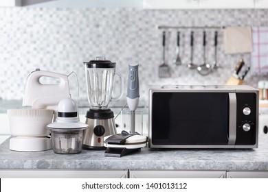 Set Of Home Appliance On Kitchen Worktop