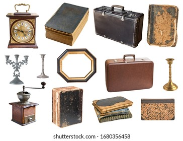 Set of a huge amount gorgeous old vintage items. Old books,desk clock, candlesticks. Isolated on white background.