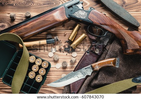 Set of  hunting equipment on desk