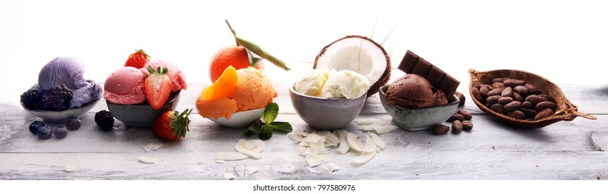 Set of ice cream scoops of different colors and flavours with berries, nuts and fruits  - Shutterstock ID 797580976