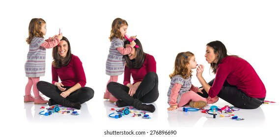 Set images of mother and daughter playing with makeup