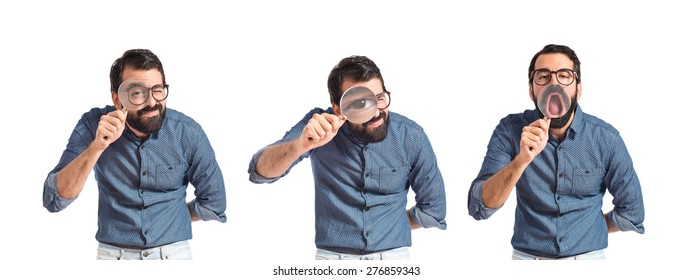 Set images of young hipster man with magnifying glass
