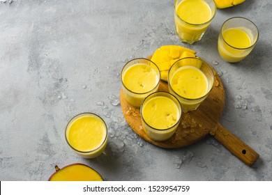 Set Indian popular summer drinks Mango Lassi or yogurt served in glass