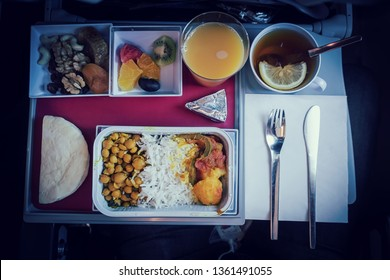 Set of inflight meal in a box, on the folding table in economy class. Feeding the passengers of Asian food on the plane in Kazakhstan. The journey tour, on the plane. food set close-up top view