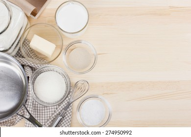 Set of ingredients for baking homemade bread on wooden background