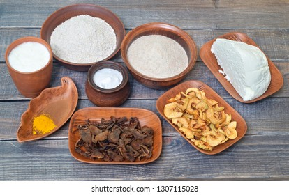 A set of ingredients for making sweets on a wooden table.