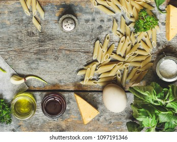 set of ingredients for pasta with creamy sauce (penne with creamy sauce and pancetta) - cuisine.  Food background