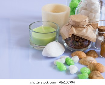 set ingredients and spice for aromatherapy and body care on a white surface with reflection. SPA still life