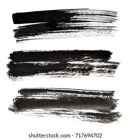 Set of ink black brush strokes isolated on the white background