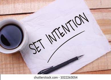 Set Intention. Motivational inspirational quotes words. Wooden background