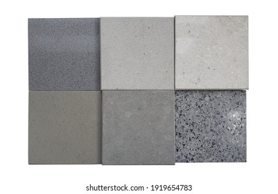 set of interior stone material tile samples in grey and beige tone isolated on white background with clipping path. grained quartz and glossy grey terrazzo samples used for interior construction.