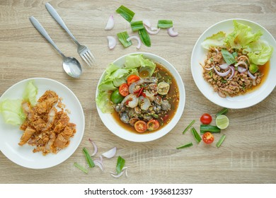 Set of Isan Spicy Salad with Deep Fried Pork Belly Spicy Salad with Cockles and Shrimp