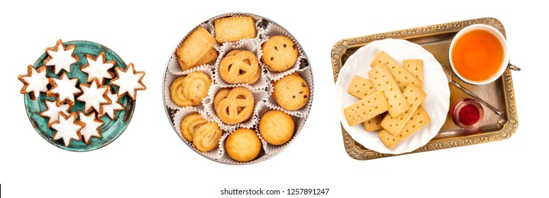 A set of isolated Christmas biscuits. German Zimtsterne, cinnamon star cookies, Danish butter cookies, and British shortbreads, shot from the top on a white background