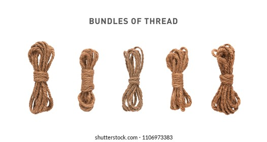 A set of isolated coils of coarse hemp rope.