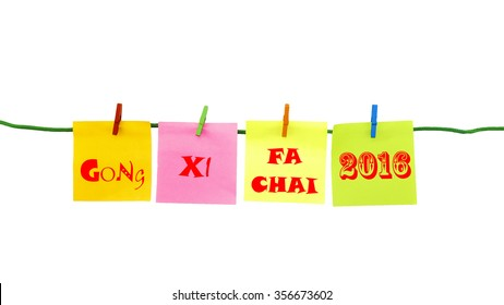 A set of isolated colorful sticky notes with written words GONG XI FA CHAI (mean - Wishing You Enlarge Your Wealth) - greeting concept.