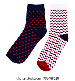 Set of isolated dark blue sock with red peas and isolated white sock with stripes of blue and red color on a white background.