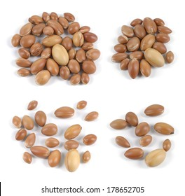 Set of isolated groups of argan nuts on white background.