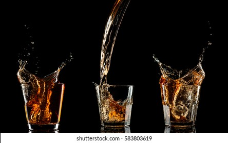 set of Isolated shots of whiskey with splash on black background