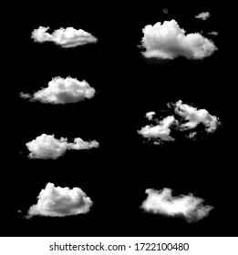 Set of isolated white clouds against black background
