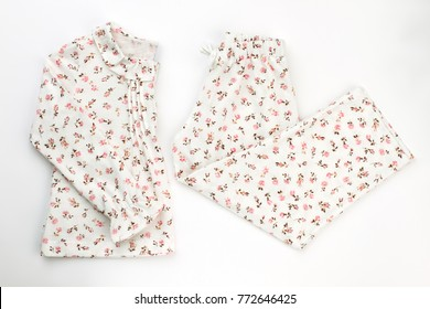 Set of jacket and pants. Beautiful flower pattern over white fabric. New collection of cozy sleepwear for little ladies.
