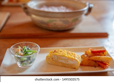 set of Japanese breakfast egg roll salad and potato
