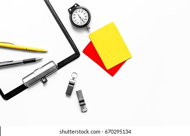 Set to judge competition. Yellow and red cards, stopwatch, whistle, pad on white background top view copyspace