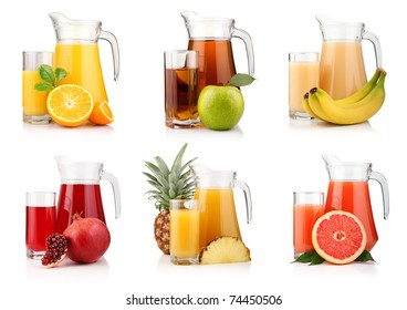 Set of jugs and glasses with tropical fruit juices isolated on white background