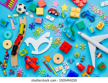 Set of kids toys on blue background. Top view, flat lay.