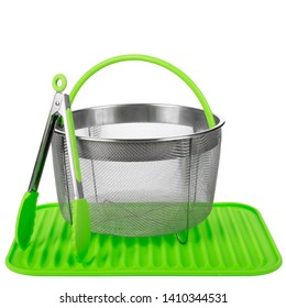 set for kitchen - metal basket, tong and silicone mat isolated