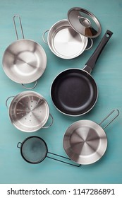 Set of kitchen metallic pans. Mockup, kitchen utensils, recipe book, cooking classes concept