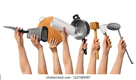 set of the kitchen tools in human hands, on white background