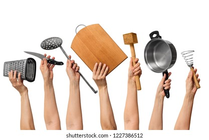 set of the kitchen utensils in human hands, on white background